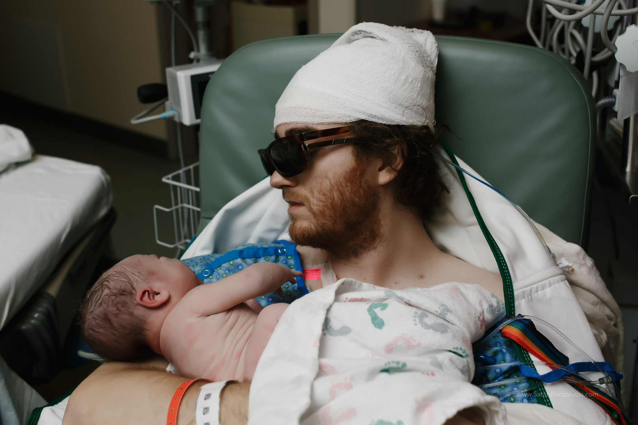 Boulder, Colorado Birth Photography, Dad with brain cancer holding baby